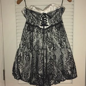 bebe Dresses - Bebe black/white lace bubble dress corset back